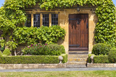 Brown Wooden Doors To Traditional English Stoned Cottage, Garden Royalty Free Stock Photography