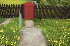 Brown Wooden Fence And A Red Gate Royalty Free Stock Photography