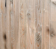 Brown wooden fence, close up, texture, background. Natural wood. Vertical bars Royalty Free Stock Photography