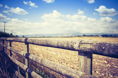 Brown Wooden Fence Under Cloudy Sky during Daytime Stock Image