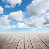 Brown wooden floor and cloudy sky Stock Photography