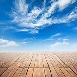 Brown wooden floor perspective and cloudy sky. Brown wooden floor with perspective and bright cloudy sky Stock Image