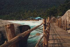 Brown Wooden Footbridge Beside Body Of Water Royalty Free Stock Photography