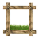 Brown wooden frame against a white background with grass and copy space in the center Royalty Free Stock Image