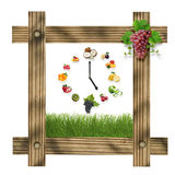 Brown wooden frame with green grass and clock arranged from heal Stock Image