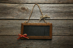 Brown wooden frame on grey wooden background. Royalty Free Stock Photos
