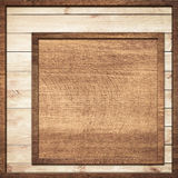 Brown wooden frame screwed on light wall planks Stock Image
