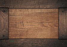 Brown wooden frame screwed on wood board Stock Photos