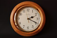 Brown Wooden Framed Clock Showing 2:19 Stock Photography