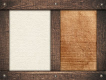 Brown wooden frames screwed on scratched wood Royalty Free Stock Photo