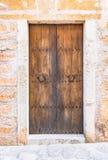 Brown wooden front door Stock Images