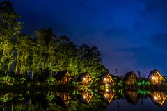Brown Wooden House Near Body of Water during Night Time Stock Photography