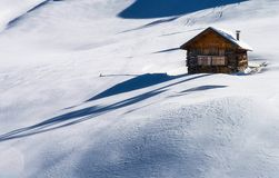 Brown Wooden House on Snow Royalty Free Stock Photos