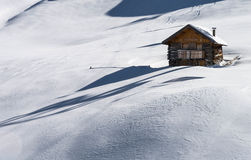 Brown Wooden House on Snow Stock Image