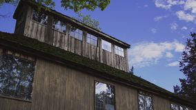 Brown Wooden House With Window Glass Under Clear Cloudy Sky Royalty Free Stock Images