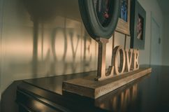 Brown Wooden Love Free Standing Letter on Black Wooden Surface royalty free stock photos