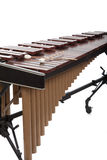 A brown wooden marimba on a white background. A wooden marimba and mallets on a white background Stock Photos