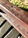 A brown wooden old railing painted with brown peeling paint. The background. Close view stock photography