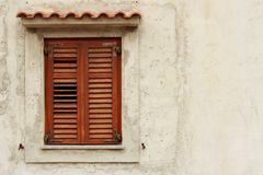 Brown Wooden Old Window on a Beige wall Stock Photos