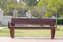 Brown wooden park bench Stock Photography