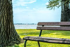 Brown wooden park bench Royalty Free Stock Image
