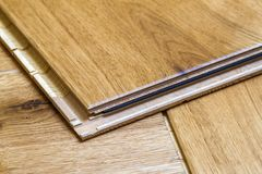 Brown wooden parquet floor planks installation , close up. Carpe Royalty Free Stock Image