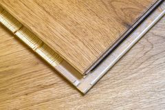 Brown wooden parquet floor planks installation , close up. Carpe. Ntry concept Royalty Free Stock Images