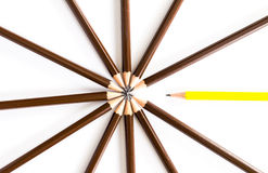 Brown wooden pencil arrange as circular with one of different pe Stock Photography