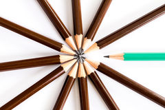 Brown wooden pencil arrange as circular with one of different pencil try to close the gap on white background , un matching and co Royalty Free Stock Photography