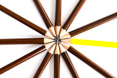 Brown wooden pencil arrange as circular with one of different. Pencil try to close the gap on the white background , un matching concept Royalty Free Stock Photos