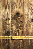 Brown wooden planks with gold ribbon. Royalty Free Stock Photo