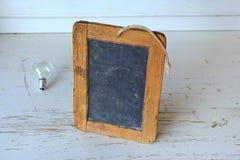 Brown Wooden Rectangular Photo Frame on White Wooden Table Stock Photos