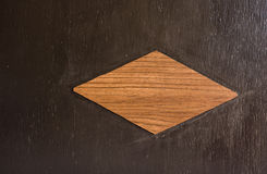 Brown wooden rhombus Stock Photos