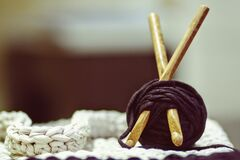 Brown Wooden Rod and Purple Yarn Ball Beside White Braided Cloth Royalty Free Stock Image
