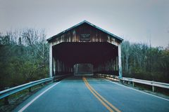 Brown Wooden Roof Bridge at Daytime Royalty Free Stock Photography
