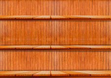 Brown wooden shelf on the wall. Use for products or book display Stock Images