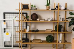 Brown wooden shelves with stuff. At home Royalty Free Stock Image