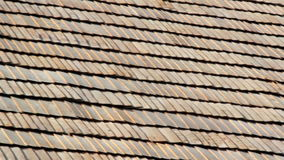 The brown wooden shingle shake roof of a big house stock video