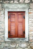 Brown wooden shutters in old stone house Royalty Free Stock Photography