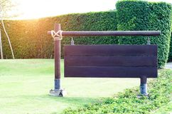 Black sign in the garden. royalty free stock photography