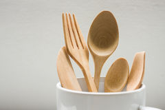Brown Wooden Spoon. In Cup On White Background Royalty Free Stock Photo