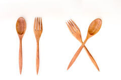 Brown wooden spoons and fork on white background Stock Photo