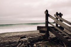 Brown Wooden Stair Near Seashore Under Dark Sy Royalty Free Stock Photos