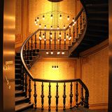 Brown Wooden Stairs and Chadelier Stock Photos