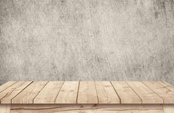 Brown wooden table top near scratched grunge wallpaper. Brown wooden table top near scratched grunge wallpaper Stock Photo