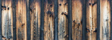 Brown wooden texture. Blank striped wooden panoramic texture for background. Vintage faded wall with knots stock images