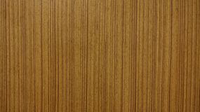 Brown wooden texture with straight wood grain, Brown wooden background royalty free stock photos