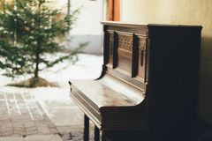 Brown Wooden Upright Piano in Shallow Focus Lens stock image