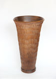 Brown wooden vase isolated on white background stock photo