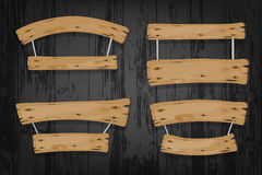 Brown wooden vector banners and ribbons hanging on. Ropes on wooden background Royalty Free Stock Photos
